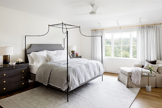 Benjamin Moore Simply White Bedroom with white oak hardwood flooring and neutral rug #benjaminmooresimplywhite #bedroom #whiteoak #hardwoodflooring #neutralrug
