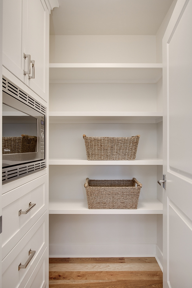 Pantry Kitchen Pantry paint color Benjamin Moore White Dove Pantry Kitchen Pantry Pantry features a combination of built-in cabinets with a built-in microwave and open shelves #pantry #pantrypaintcolor #openshelves #builtincabinet #pantrycabinet