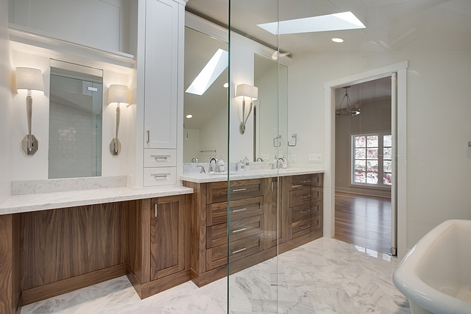 Bathroom cabinet The bathroom features custom a cabinet with his and hers sinks and a make-up vanity #bathroom #cabinet #bathroomcabinet