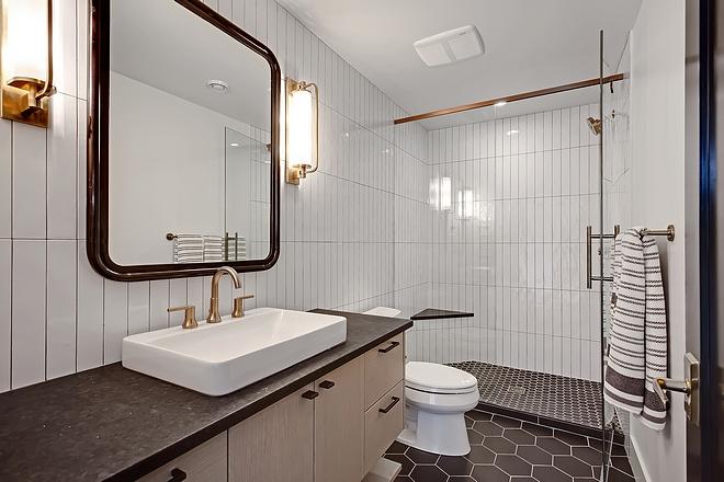"Basement Bathroom basement bathroom features heated 8"" matte hexagon black tiles and leathered Black Granite countertop #basementbathroom #basement #bathroom"
