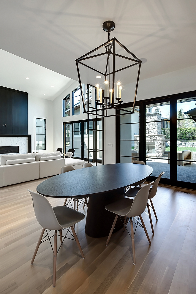 Modern farmhouse breakfast room with black steel patio doors and black pendant light #breakfastnook #pendantlight #blacklighting #blacksteel #patiodoor #steelpatiodoor #blackwindows #modernfarmhouse