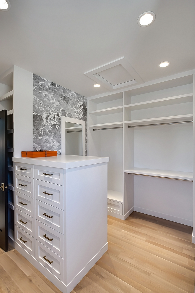 Walk in closet This oversized walk-in closet has extensive shelving, shoe area, seating bench, full length framed mirror and over 15 built-in drawers