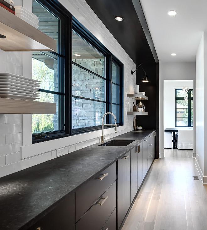 Leathered Angola Black GraniteBlack Granite Countertop Kitchen with dark wood cabinets and black countertop Leathered Angola Black Granite #LeatheredAngolaBlackGranite #AngolaBlackGranite #LeatheredBlackGranite