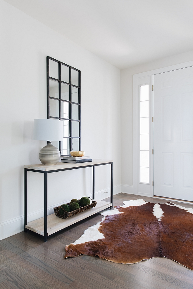 Benjamin Moore Classic Gray The front door opens to a bright foyer with light grey walls, Benjamin Moore Classic Gray, and beautiful hardwood flooring Benjamin Moore Classic Gray Benjamin Moore Classic Gray #BenjaminMooreClassicGray #lightgreywall #paintcolor #lightgrey #BenjaminMoore