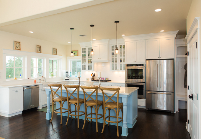 White kitchen with light tan walls and blue island Perimeter cabinets are painted in Sherwin Williams Extra White SW7006 Blue kitchen island paint color Sherwin Williams SW9061 Rest Assured #whitekitchen #bluekitchenisland
