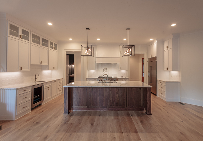 BM Super White kitchen cabinets with Walnut island and light White Oak hardwood flooring #bmsuperwhite
