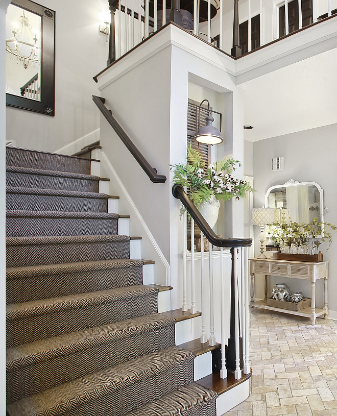 Staircase reno ideas Stair railing and post are painted in Sherwin Williams Tricorn Black Herringbone Stair Runner #staircasereno #Stairrailing #railingpaintcolor #SherwinWilliamsTricornBlack #HerringboneStairRunner #StairRunner