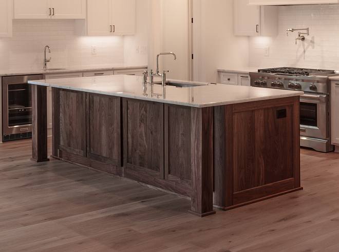 Walnut island with white marble countertop Kitchen island is Walnut (wood) in natural finish Kitchen island is Walnut (wood) in natural finish Beautiful kitchen combination of white perimeter cabinets with Walnut island #walnutisland
