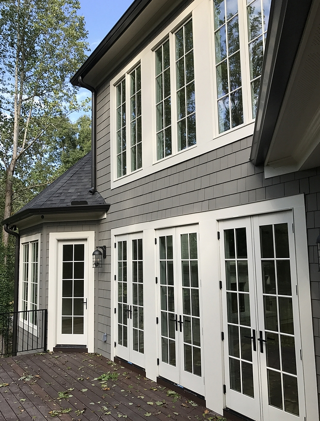 Sherwin Williams Anonymous siding with white windows and doors Sherwin Williams Anonymous Sherwin Williams Anonymous #SherwinWilliamsAnonymous