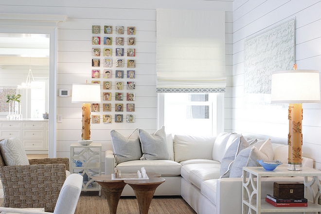 Coastal living room with corner sectional and walls clad in shiplap