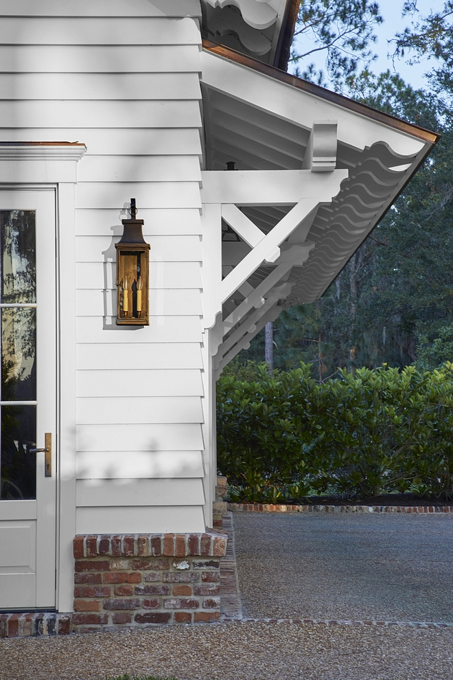 Traditional Garage Traditional details like these ornate rafter tails and brackets speak to the low-country vernacular architecture Traditional Garage Architecture #TraditionalGarage #garage #architecture