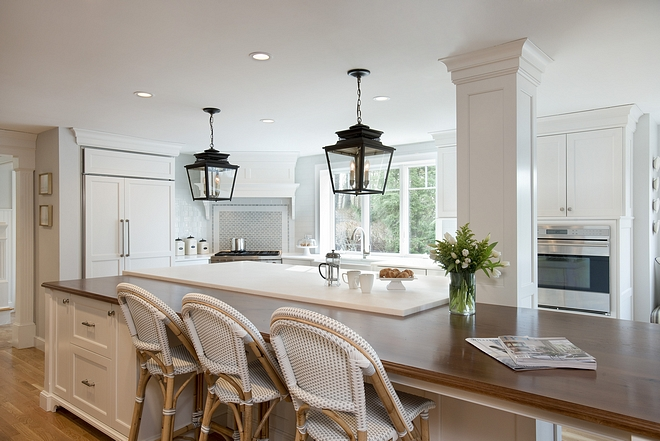 Wood Countertop Wood was introduced at the eating portion of the island to add warm notes to the kitchen and connect to the view of nature beyond #kitchen #woodcpuntertop