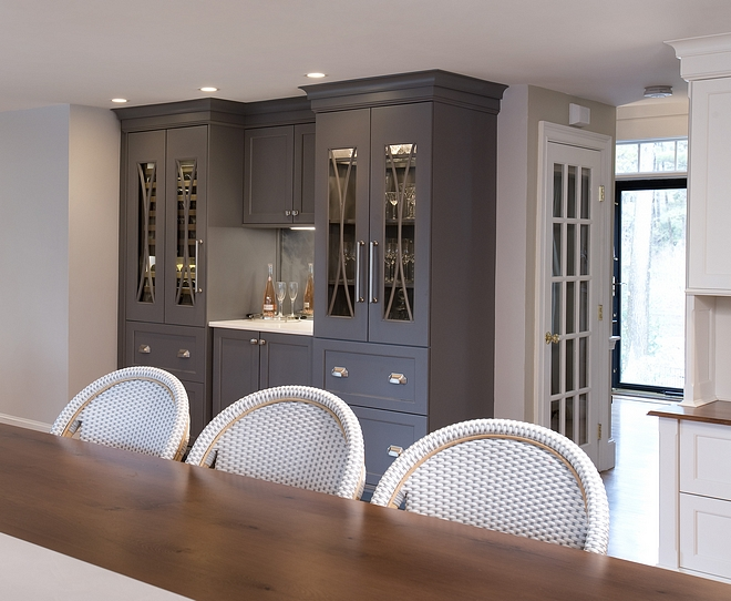 Kitchen Bar Cabinet Purposed cabinetry zones were installed including a tall pantry with many pullouts and custom shelving as secondary storage for dry goods and appliances #kitchen #barcabinet #kitchenbar