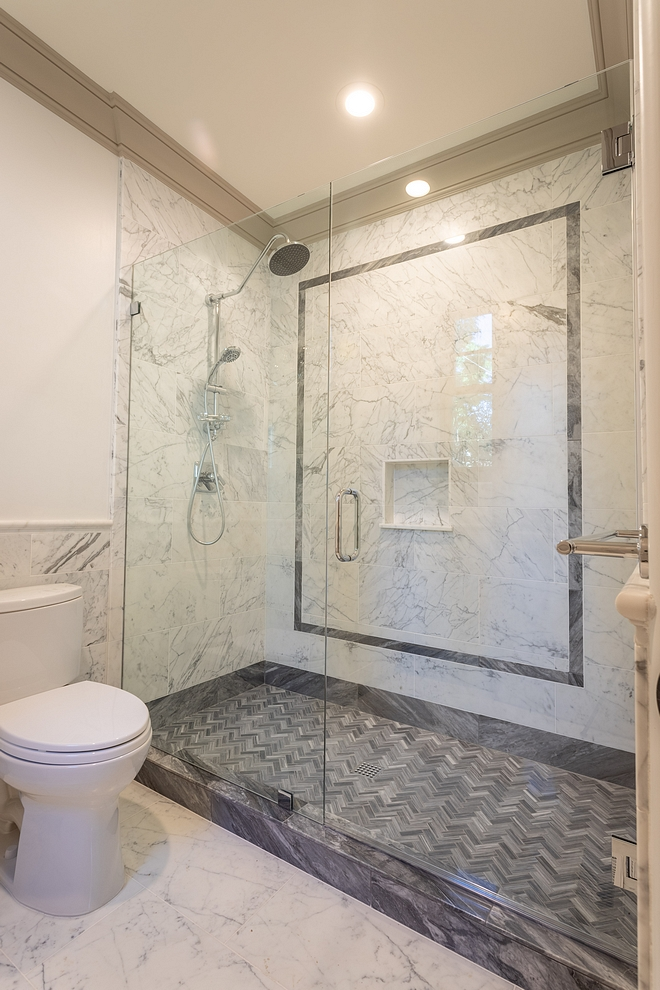Bardiglio Nuvolato marble tile Bathroom Tile Grey and white marble tiling add some drama and an inspiring color scheme to this bathroom White and Grey Bathroom Tile with grey trim #WhiteandGreytile #BathroomTile