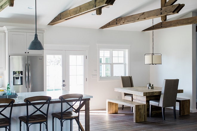 Breakfast Nook The breakfast nook was kept simple with a dining table and bench set, clean-lined dining chairs and a drum chandelier #BreakfastNook