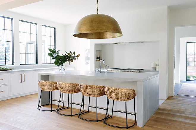 Kitchen Lighting Our client really pushed for the single-pendant over their custom concrete island. She wanted something minimalist, large scale, that added a modern glam element to the room #kitchenlighting #kitchen #lighting