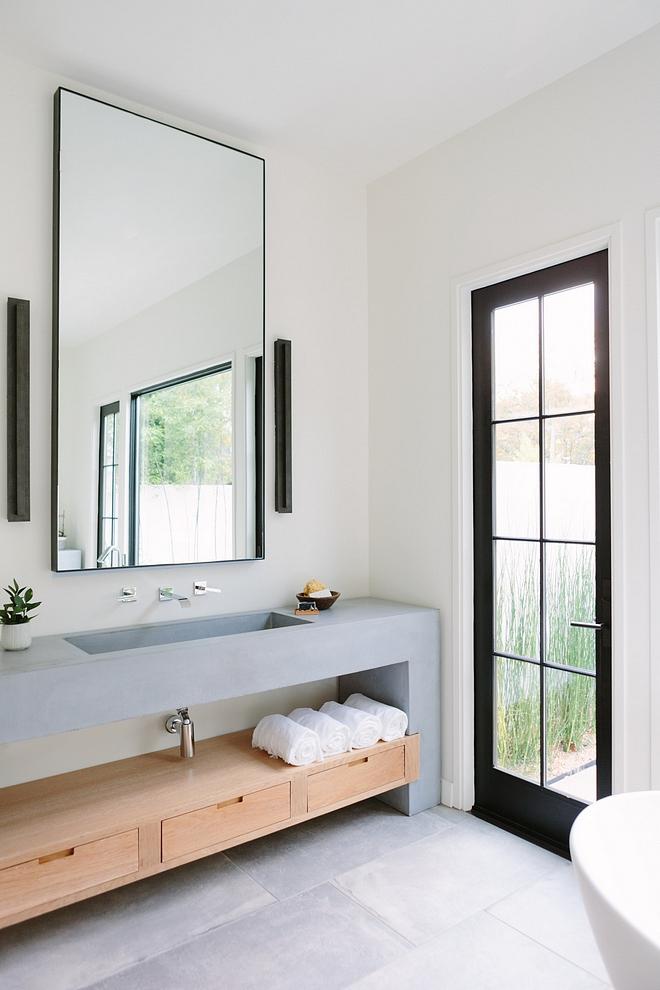 Bathroom Vanity The master bathroom features an unique concrete and wood vanity #Bathroom #bathroomvanity #concretevanity #woodvanity