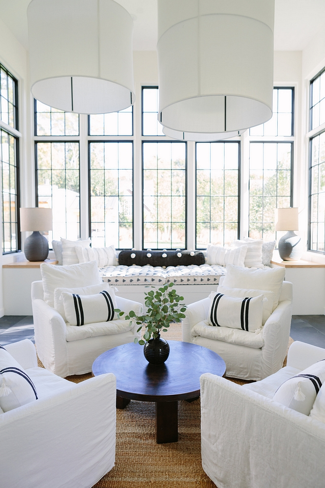 Chair sitting are The four chairs in the center of the room and the huge fabric pendants make the room feel cozy enough for intimate gatherings #chairs #sittingarea