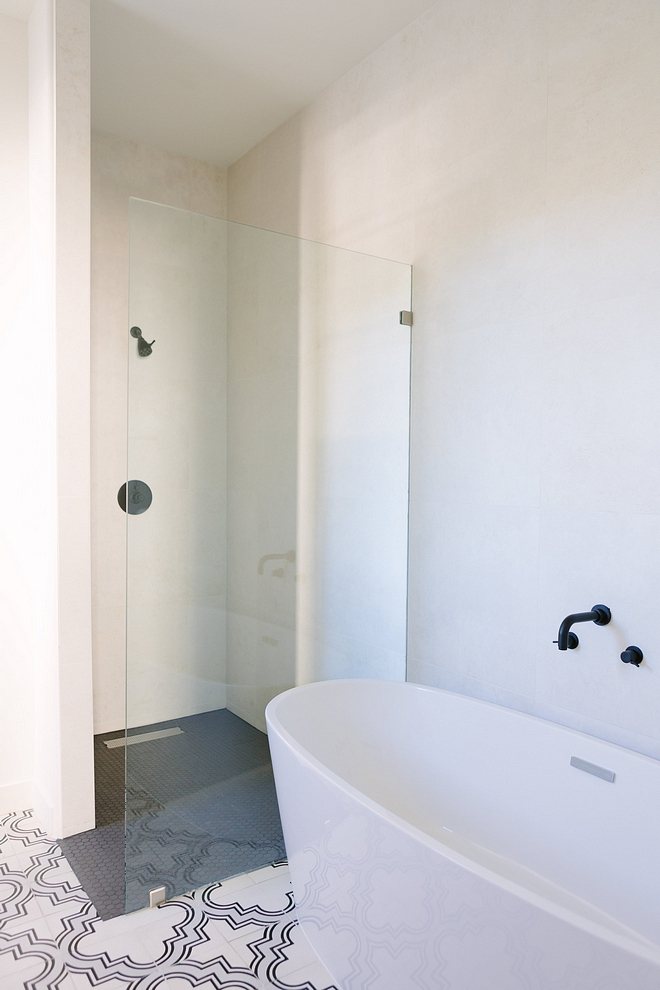Curbless Shower This bathroom also features a simple curbless shower and a freestanding tub #CurblessShower
