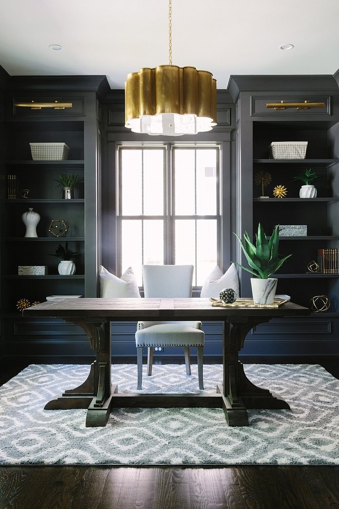 Home Office The home office features a built-in banquette flanked by bookcases with cabinet lighting #homeoffice #builtin #windowseat #banquette