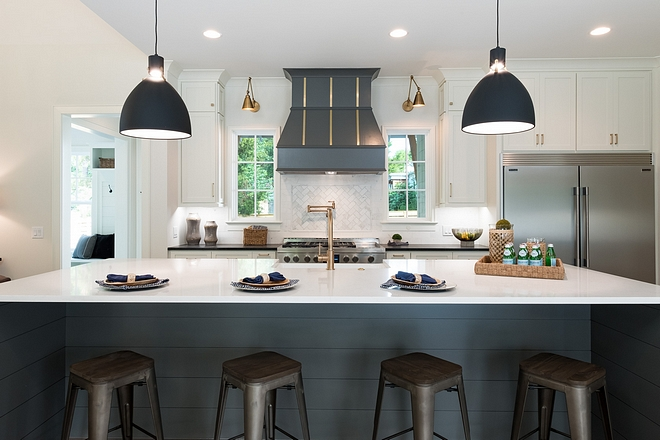 Two toned kitchen The variation in colors and textures makes this kitchen stand out from the rest. The center island is a whooping 11' in width Two toned kitchen #Twotonedkitchen