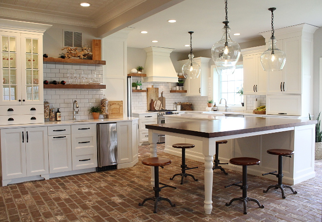 Farmhouse White Kitchen Farmhouse White Kitchen with l-L-shaped kitchen island and brick flooring #FarmhouseWhiteKitchen #FarmhouseKitchen #WhiteKitchen