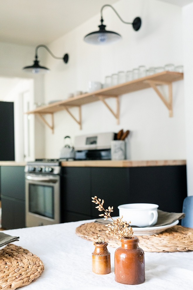Farmhouse Kitchen Renovation How to renovate a farmhouse kitchen on a budget Ikea Cabinets Home Depot Countertops Barn Sconce Light All souces on the blog #reno #kitchenreno #farmhousekitchenreno #budgetreno