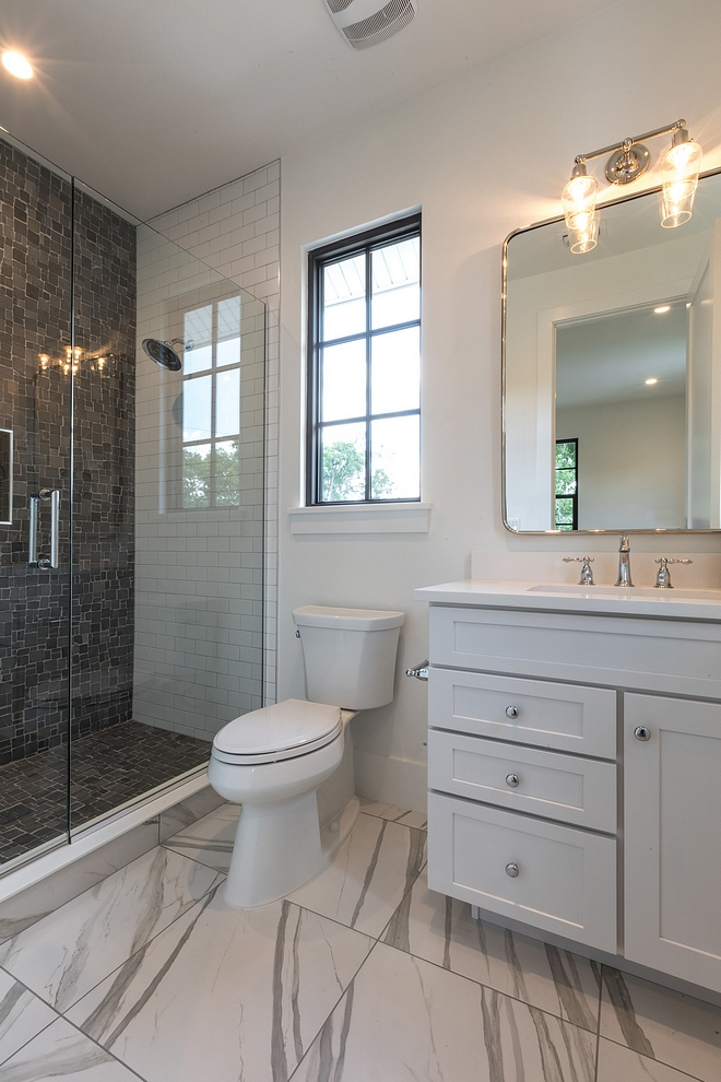 Large floor tiles are a favorite of mine for bathrooms! They tend to be simple and don't make the space feel busy #bathroom #tile #bathroomtile #largetile