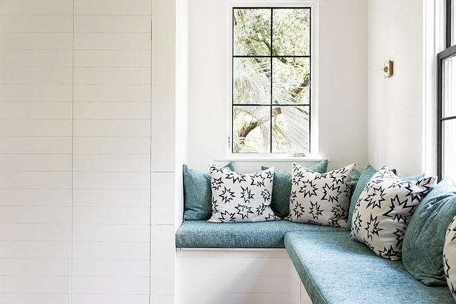 """The playroom features a custom Banquette in Kelly Wearstler fabric with pillows in Kate Loudon Shands """"POW"""" fabric #playroom #fabric #KellyWearstlerfabric"""