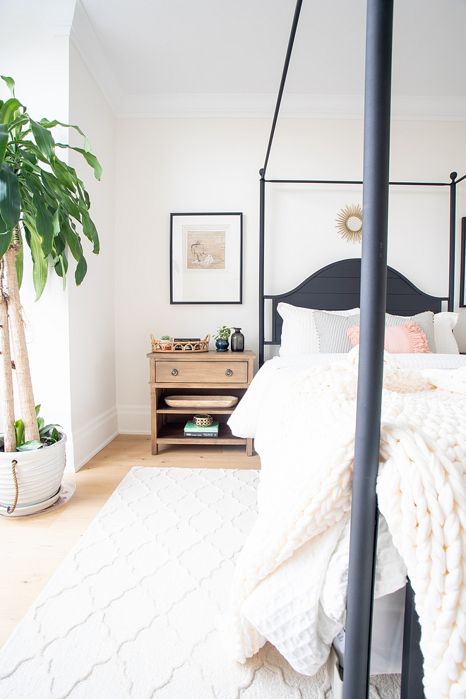 White Dove Benjamin Moore Bedroom Wall paint color with natural Chunky Knit Throw and black canopy bed
