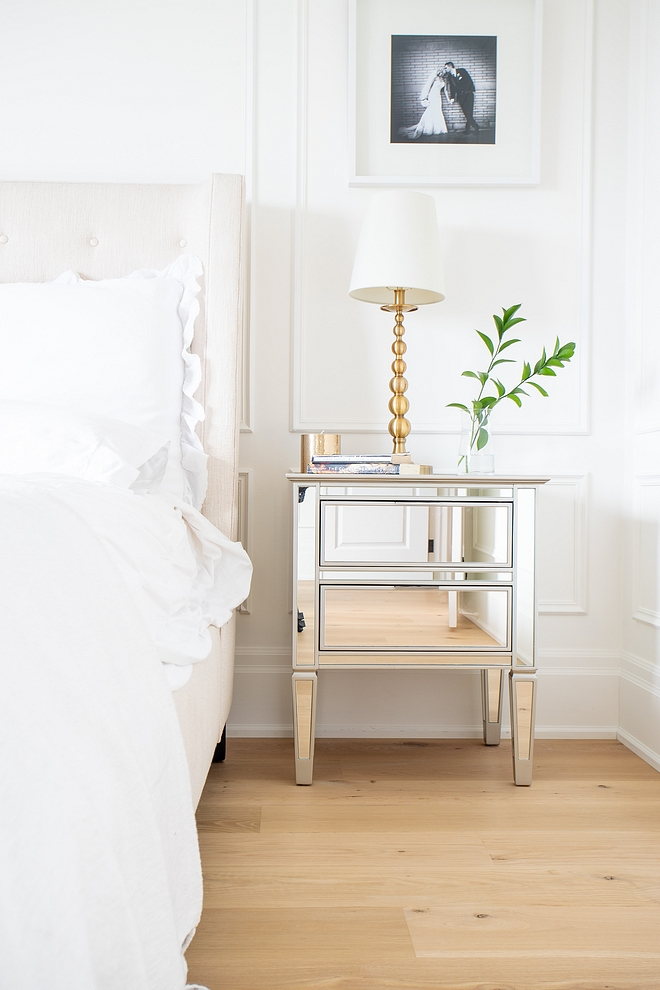 Mirrored Nightstand Timeless way to decorate a bedroom Wainscoting Tufted bed White bedding Mirrored Nightstand and White Oak hardwood flooring Mirrored Nightstand #MirroredNightstand #bedroom #decor #bedroomdecor