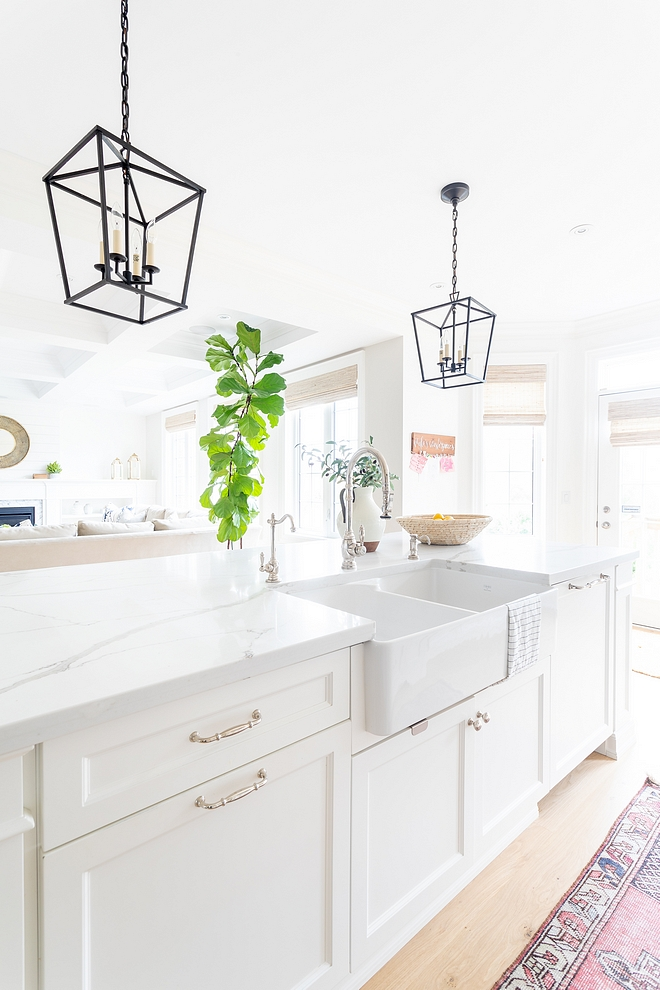 White Kitchen Island Paint Color Benjamin Moore Simply White with Double Basin Farmhouse Kitchen Sink and Calacatta Quartz Countertop #kitchenisland #whitekitchenisland #DoubleBasinFarmhouseSink #BenjaminMooreSimplyWhite
