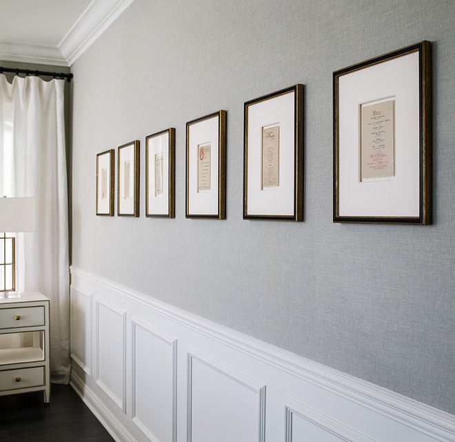 Light grey grasscloth wallpaper above chair rail wainscot