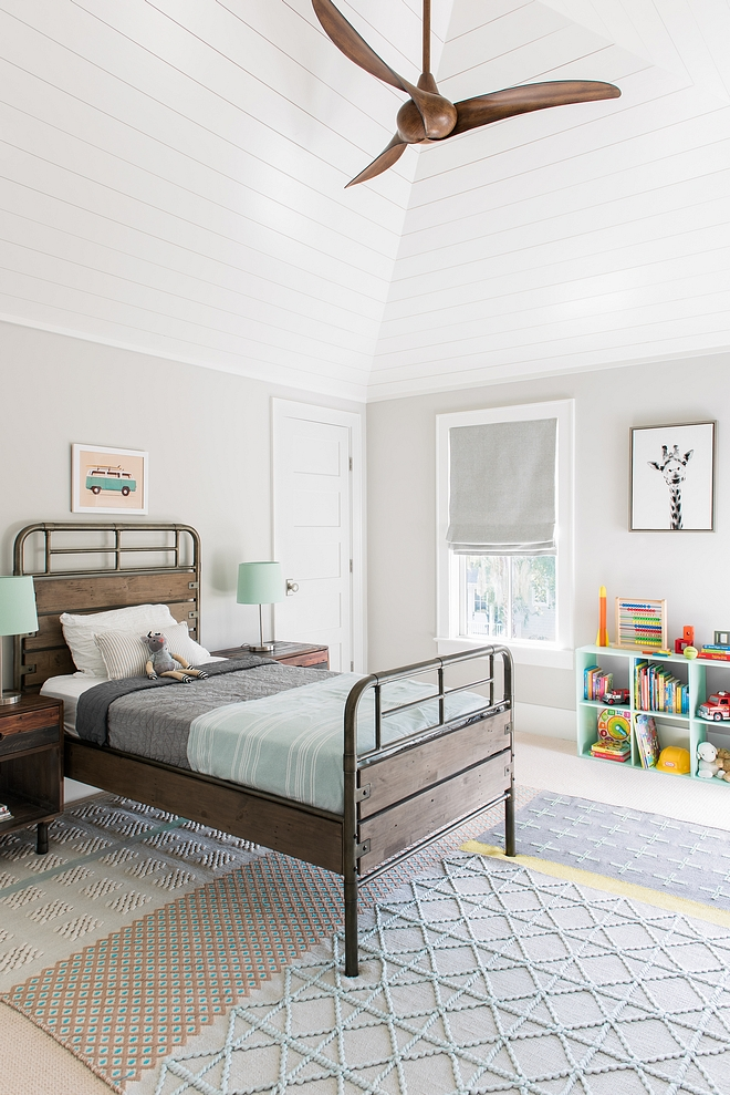 Benjamin Moore Rodeo This boys bedroom features a fresh and happy color palette. Also notice the vaulted ceiling with shiplap Bedroom paint color Benjamin Moore Rodeo #BenjaminMooreRodeo #boysbedroom #shiplap #vaultedceiling