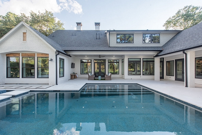 Modern Farmhouse Pool New Pool Design Modern Farmhouse Perfect combination of architectural details are carried from the home to the pool design #ModernFarmhousePool #ModernFarmhouse #Pool #newpool #newpooldesign