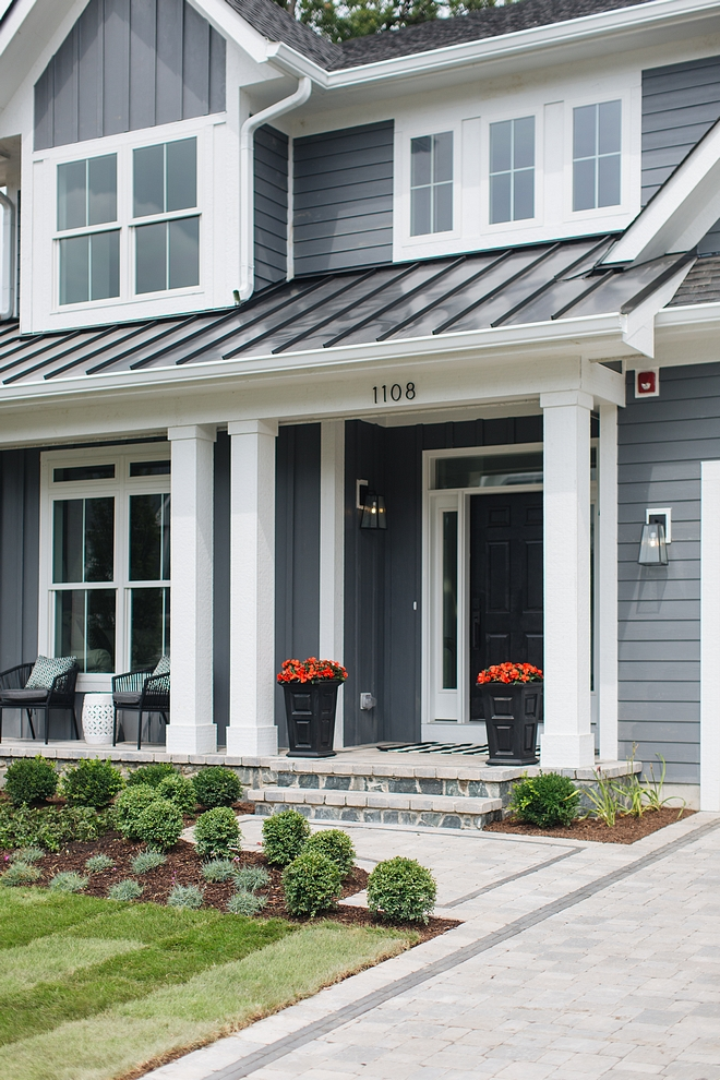 Porch Façade Stone Rustic Blue Machine Cut Driveaway and Paver front porch with black brick details #PorchFaçade #Stone #Driveaway #Paver #frontorch