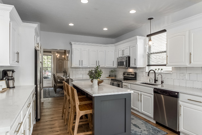 Kitchen Renovation How to paint kitchen cabinets and save money on a kitchen renovation DIY island new laminate flooring keep the same cabinets but repaint them in a popular white paint color by Benjamin Moore #kitchenreno #kitchenrenovation #kitchenremodel