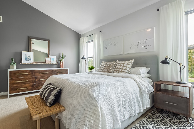 Mid-century farmhouse bedroom design We decided to flip the typical dark accent wall, with one light wall as the focal point instead