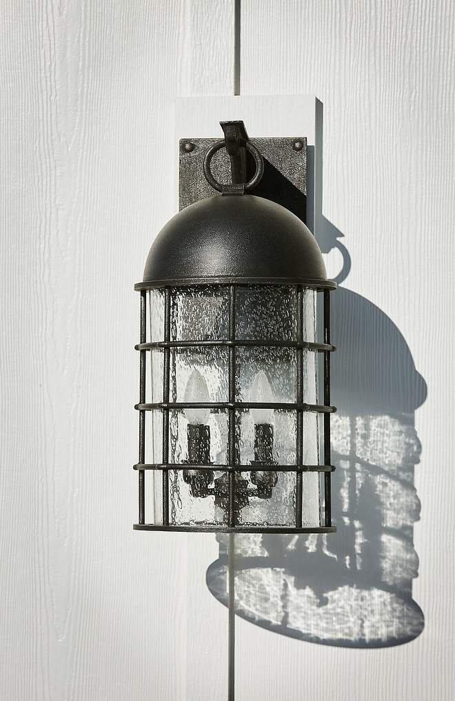 Exterior Lighting Exterior sconce Black with seeded glass exterior sconce source on Home Bunch Exterior Lighting Exterior sconc #ExteriorLighting #Exteriorsconce #lighting