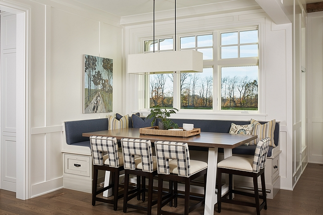 Breakfast room The breakfast room features a counter-height table and counterstools with a custom elevated banquette #breakfastroom #banquette