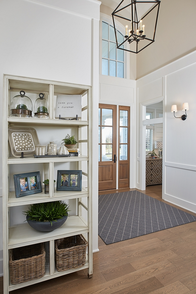 Foyer horizontal board and batten Paneling A custom front door opens to a stunning foyer with White Oak hardwood flooring, arched ceiling and horizontal board and batten paneling #Foyer #horizontalboardandbatten #boardandbatten #Paneling
