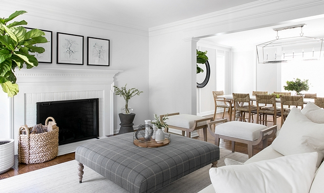 When designing both the living and dining rooms, we wanted the spaces to feel inviting and approachable, but also have some formality because the family enjoys entertaining and hosting gatherings often. We focused on furnishings that had tailored, clean lines and brought in warmth through the use of textiles and textures that felt a little more casual to achieve this balance.