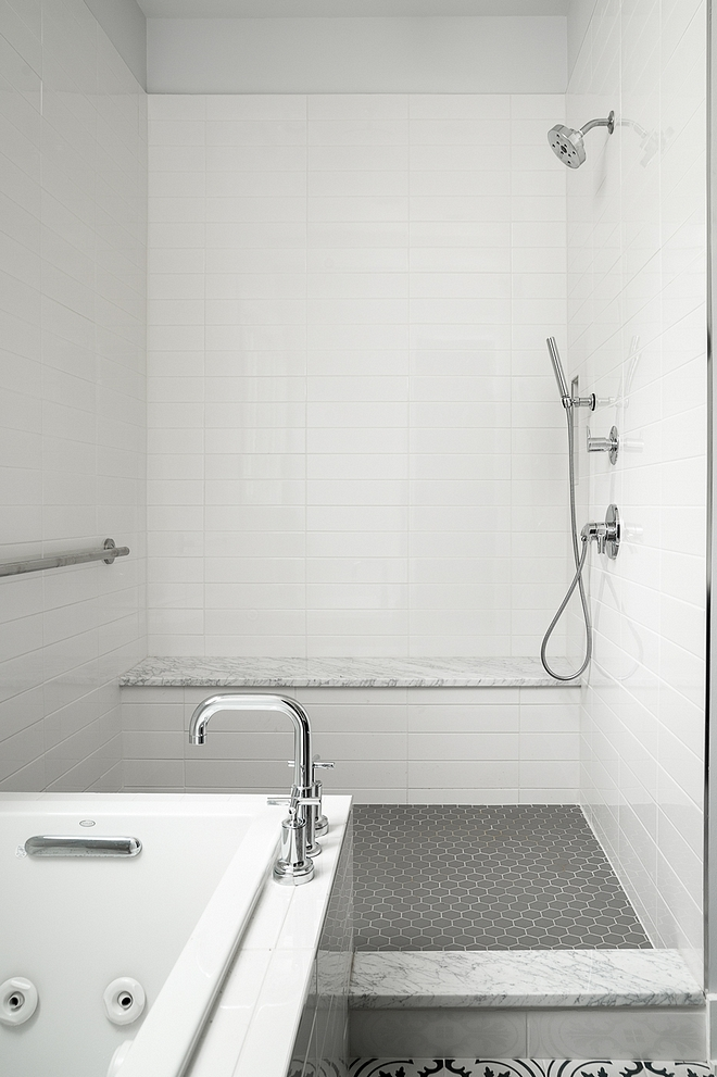 White subway tile with grey floor tile and white marble bench slab to give this affordable shower a more expensive feel #shower #tile