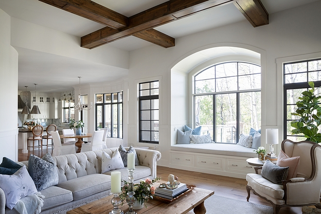 Reading nook Modern farmhouse living room with inviting reading nook with arched windows Reading nook Reading nook #Readingnook #archedwindows #farmhosue #modernfarmhouse #farmhouse
