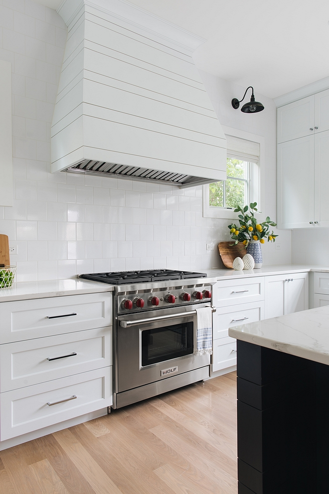 Shiplap Hood White shiplap hood The builder did a custom designed asymmetrical shiplap hood. They tapered the sides of the hood a bit so that it wood flair slightly at the bottom The ends of the island match the hood design #ShiplapHood #Whiteshiplaphood #kitchenhood