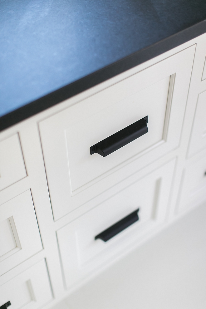 Benjamin Moore White Dove with leathered black granite countertop and black matte cabinet hardware