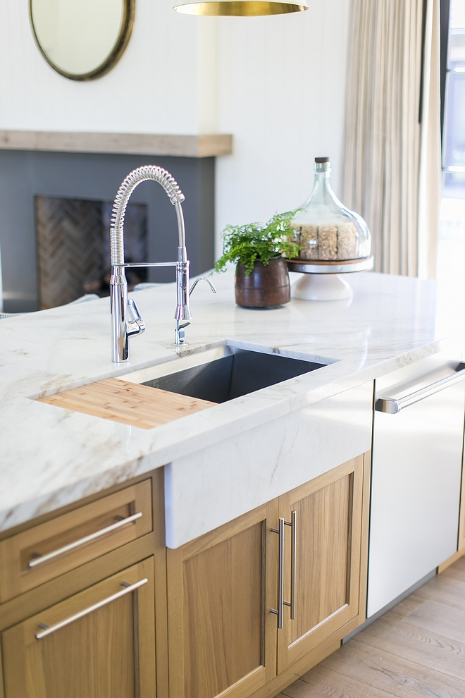 Kitchen sink The marble apron at sink came about from my conflict of I really wanting the island's long expanse of cabinets broken up by a farm sink, but also really wanting the functionality of Kohler's 8 degree sink #kitchensink #kitchen #sink #kicthen