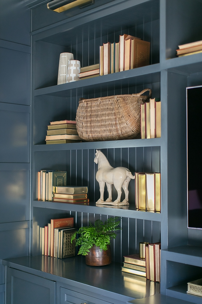 Bookcase decor Books and neutral decor add interest to the custom bookshelves #bookcasedecor