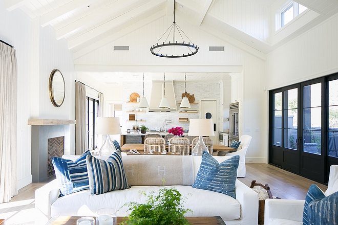 Blue and white color scheme Blue is the current accent color throughout the home, showing up on pieces like the upholstery of the kitchen bar stools and the throw pillows in a living area #blueandwhite #colorscheme
