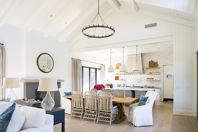 Open kitchen dining room and family room layout with different ceiling heights